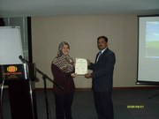 Receiving Certificate in International Conference (ICRIIS09) at Malaysia
