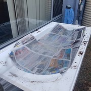 Some newspaper and additional cardboard to top it off.