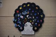 Afro Lady made out of records.