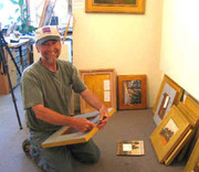 chuck_volz_framing_a_new_painting_small