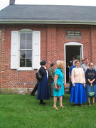 Friends coming out of the meetinghouse