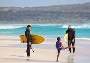 Little boy admiring surfs