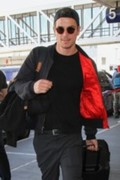 Josh Hartnett smiled for cameras as he made his way through the LAX terminal