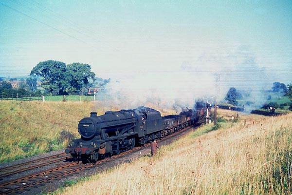 Woodford. Heavy freight coming off the GC  towards Woodford West Junction (SMJ) Ron Fisher