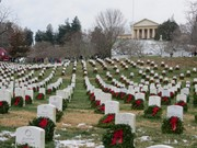 Wreaths at Arlington with the Custis Lee Mansion in the background.