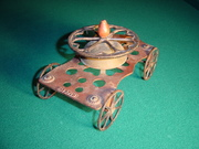 Unknown Iron Bell Toy with Heart Wheel on front
