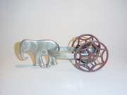 Unknown Elephant pull toy with red cast iron wheels