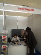 Diplo Foundation booth with Diplo fellows