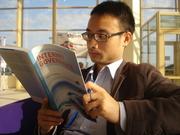 IGF12 participant reading IG Book - Photo by Grace Githaiga