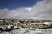 Old Jerusalem City after snowfall, as seen from Mount of Olives