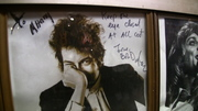"""Bob Dylan on the wall """"Keep one eye closed at all cost"""""""