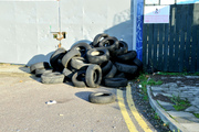 Fly tipped car tyres.
