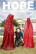 occupy-kassel-arts-documenta-show-guerilla-anonymous-mask-hope-time-guards-sculpture-manfred-kielnhofer