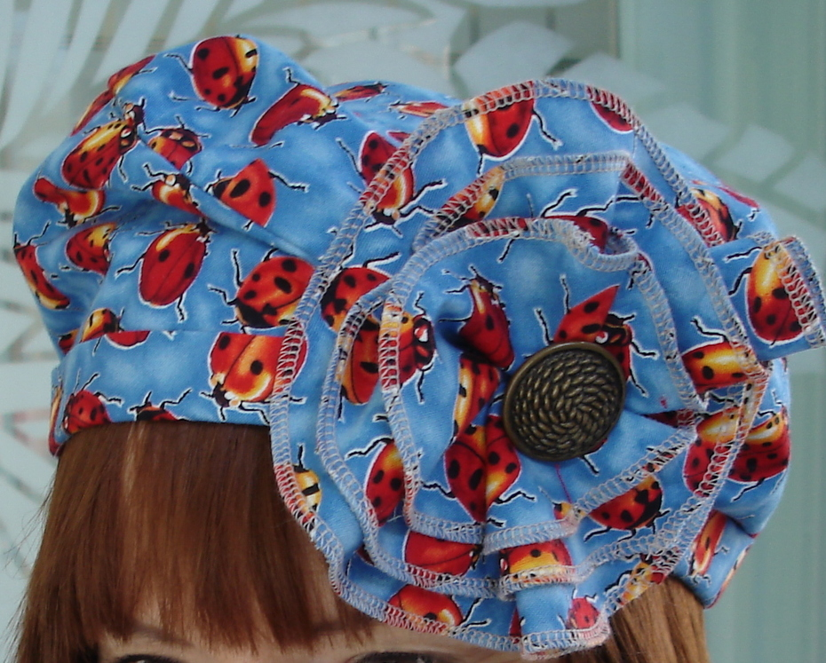 Buggy hat with serged flower