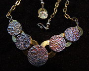 Articulated brass and fine silver