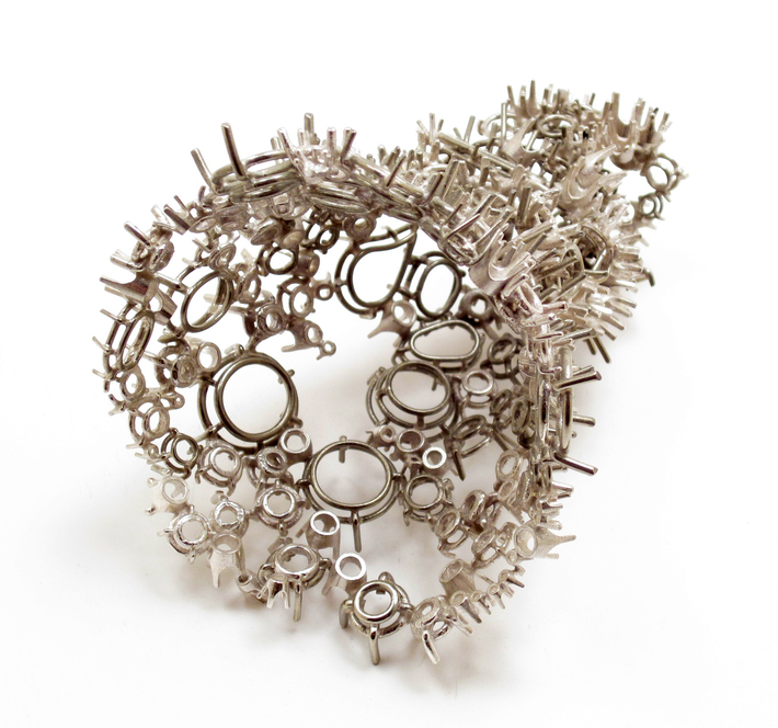 Ring in the Shape of the Caudate Nucleus Comprised of Multiple Types of Prong Settings in Three Different Types of Silver Alloys, of Which One Third Were Hand Fabricated, One Third Were Cast and the R