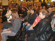An attentive audience listens to a reading from Whale Song