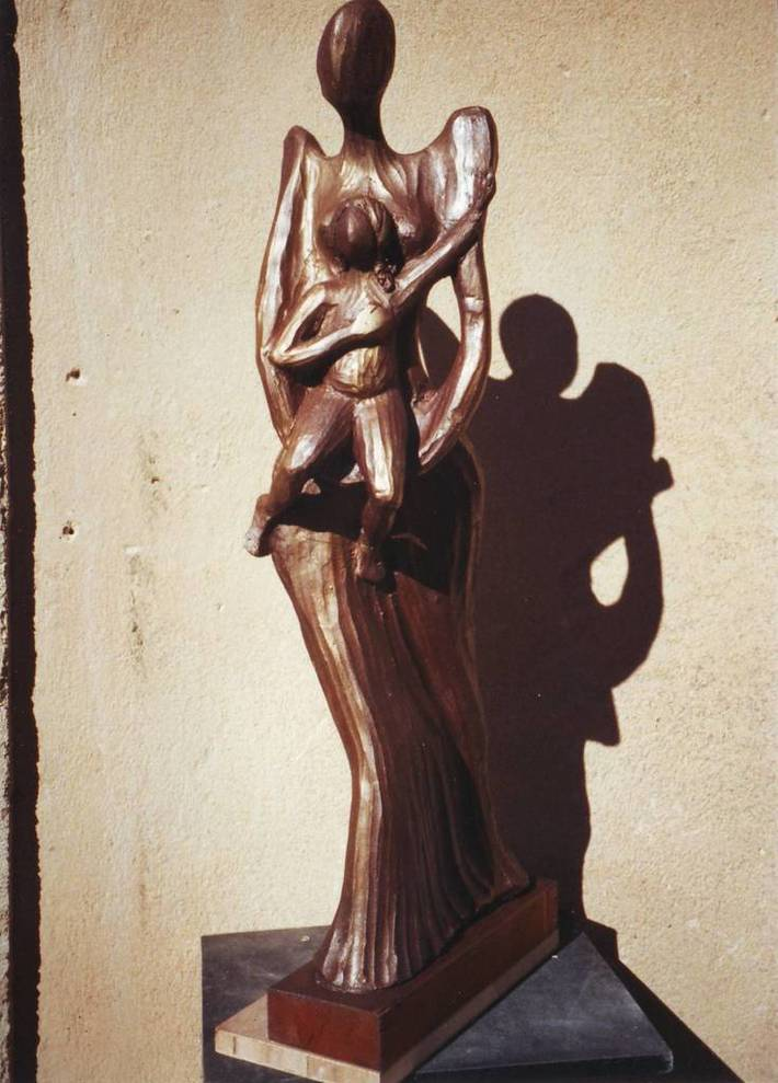 Maternità terracotta patinata