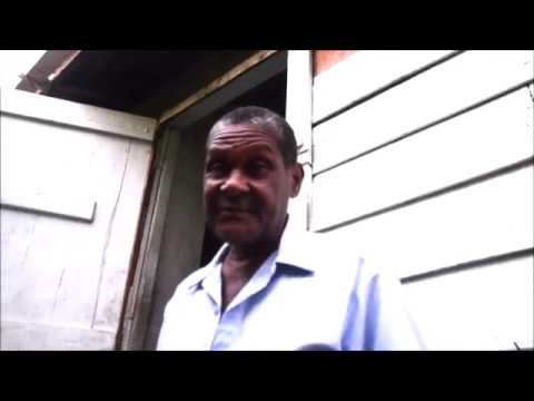 Earl Maitland meets local grenadian residents affected by illegal structure on grand anse beach