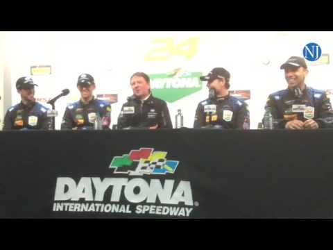 The winning team of  the 55th running of the Rolex 24 at Daytona International Speedway adress the p