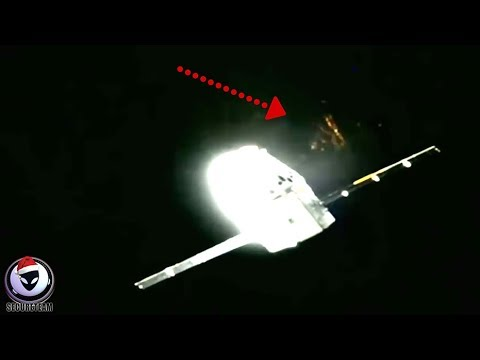 SOMETHING'S BEHIND THE DRAGON SPACE CAPSULE...