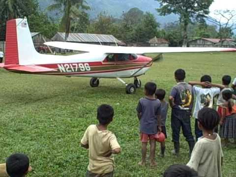 Bush pilot in Guatemala.  Cessna 182 in the jungle.