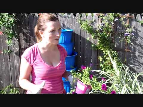 How To Reuse Old Containers to Make A Garden Tower Out Of Reclaimed Materials.wmv