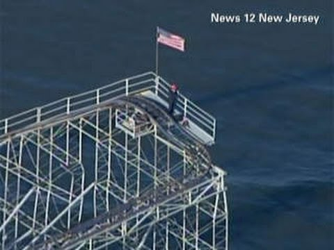 Man Climbs Sandy Ravaged NJ Roller Coaster Unfurled An American flag On It Gets Arrested