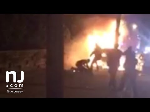 Video shows police kicking victim of fiery crash (Warning: video contains graphic content)