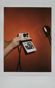 Polaroid Sx-70 Through FujiFilm Instax Mini 7