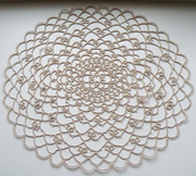 Oval doily in ecru
