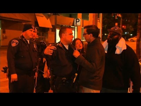 "CNN Reporter Miguel Marquez confronts Baltimore cop: ""Are we under marshal law?"