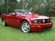 My candy apple red 09 Mustang convertible!!  Finally!!