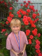 closeup of roses and soccer medal