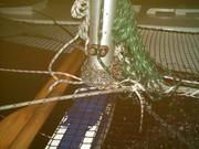 Chain round mast in thunderstorm