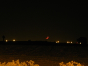 Red crescent moon setting