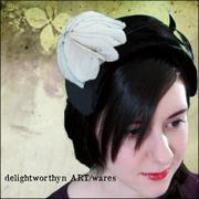 Black velvet Cocktail Hat with Stiffened Silk Flower