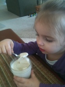 Eating her freshly made coconut yogurt