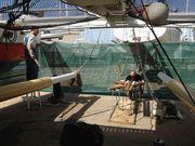 "Michaël and Thomas working ""below deck."""