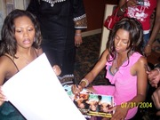 Erica P signing autographs along with Brandi of Blaque