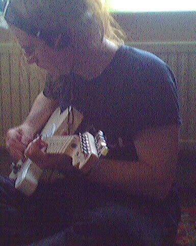 Holly with his favourite guitar Jennifer lol