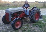 Rita glamming on tractor, and smiling, too!!!!!