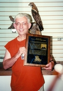 Ron holds plaque at State Park Visitor Center that was dedicated to dad