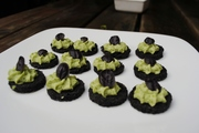 Asparagus mousse on squid ink crostini