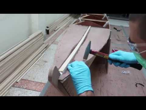 Epoxy and nail the fore and aft deck panels in place -  Wharram Hitia 14