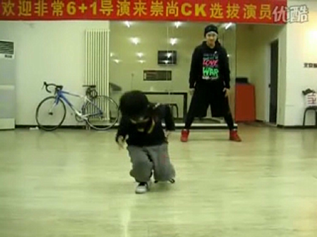 Young boy showing off his hip hop skills