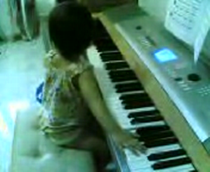 Baituey is  playing  her  create  song.