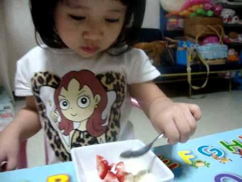 Aiko jang is eating strawberry.