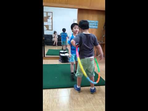 Dragon Mungon :Twins played the hula hup.