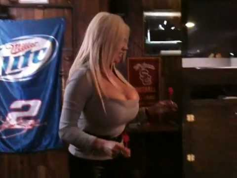 Blonde With Enormous Boobs Playing Darts